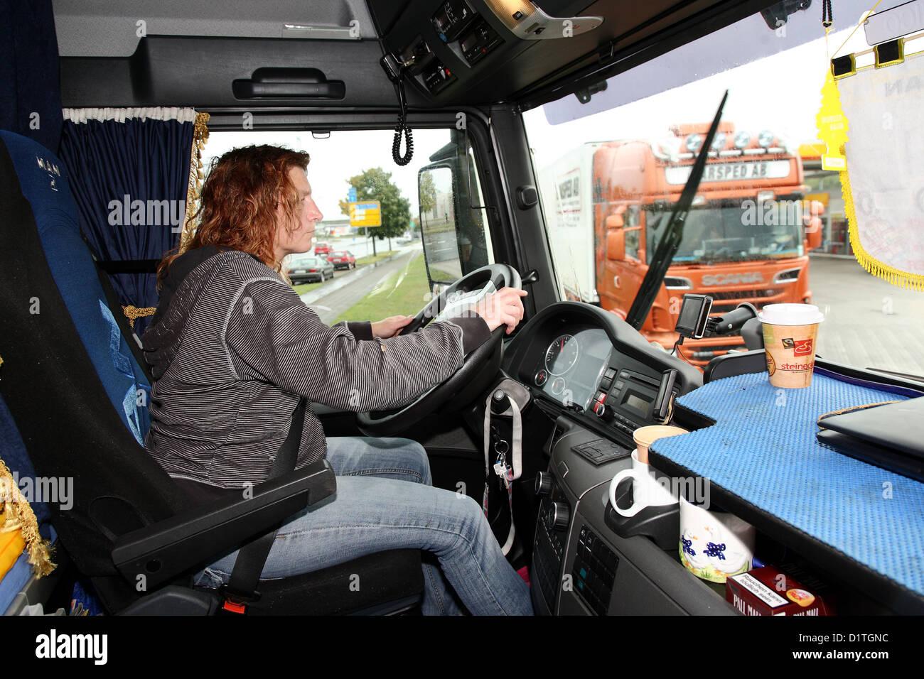Braunschweig, Germany, trucker Inge meadow behind their truck tax - Stock Image