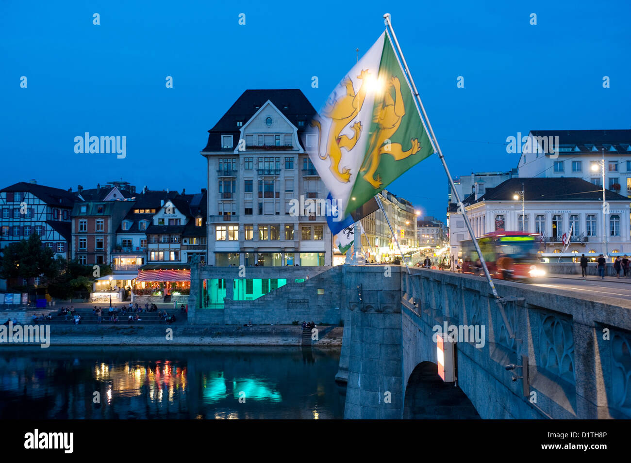 Basel, Switzerland, the middle bridge with flags of the Basel communities in the evening light Stock Photo