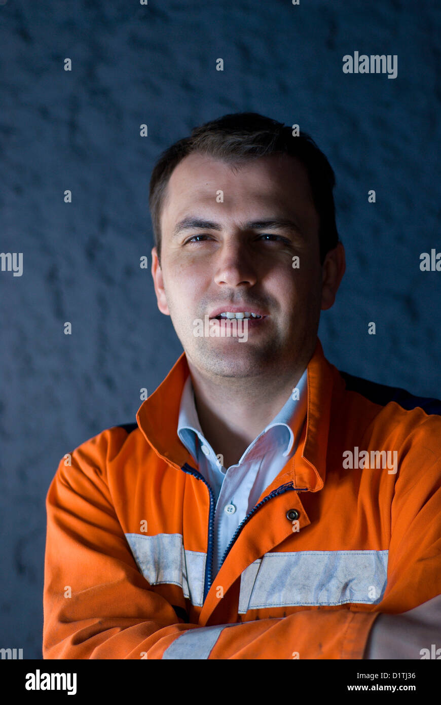 Tired worker hardly keeping his eyes open - Stock Image