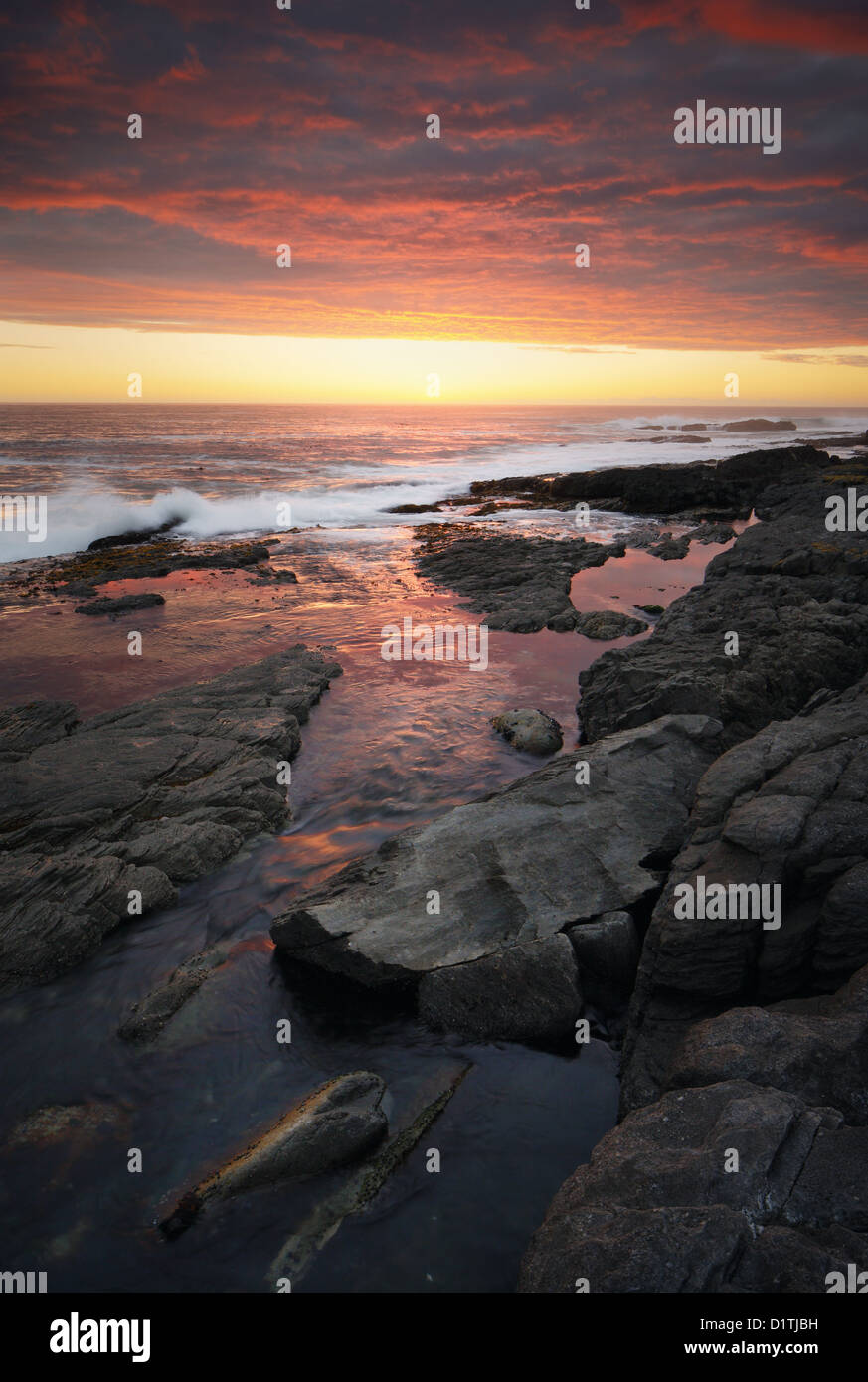 Sunset over rocky coastline (Hermanus - Cape Province - South Africa) - Stock Image