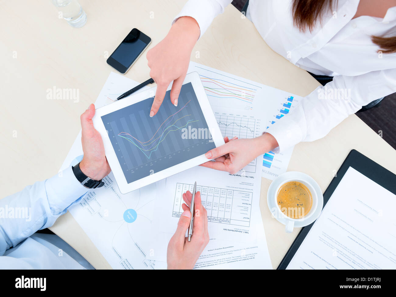 Businessman discussing with financial analyst business development strategy project and using modern digital tablet Stock Photo