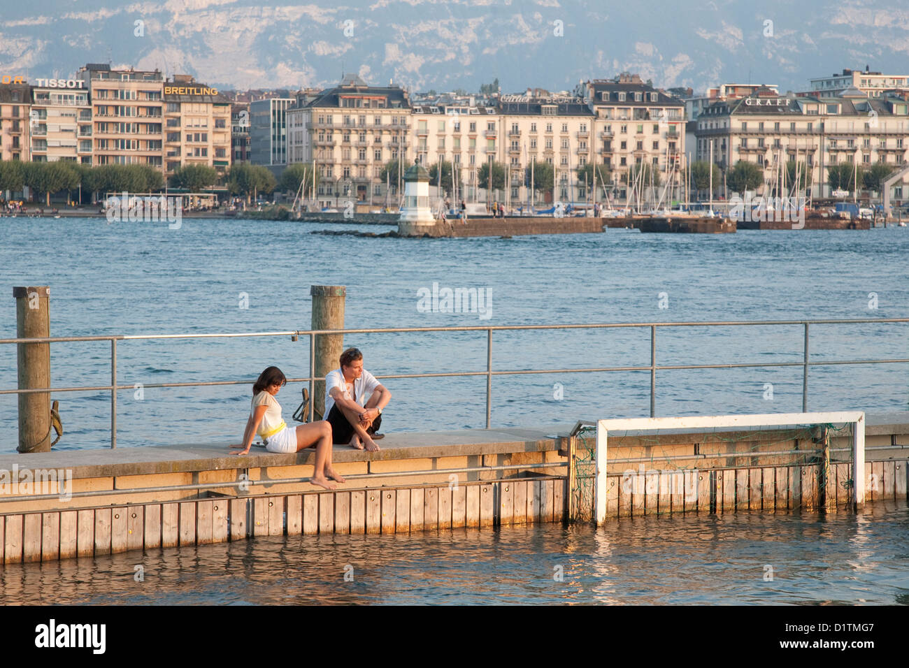 Couple relaxing by the Lake, Geneva, Switzerland, Europe - Stock Image