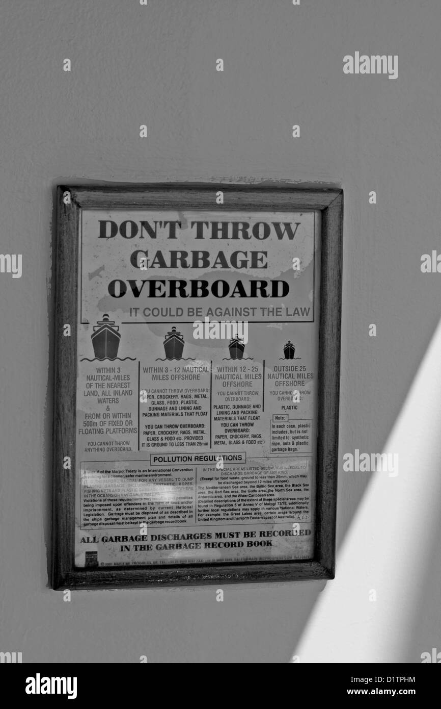 Notice on the Cunard cruise ship Queen Mary 2 advising not to pollute the sea by throwing garbage overboard. - Stock Image