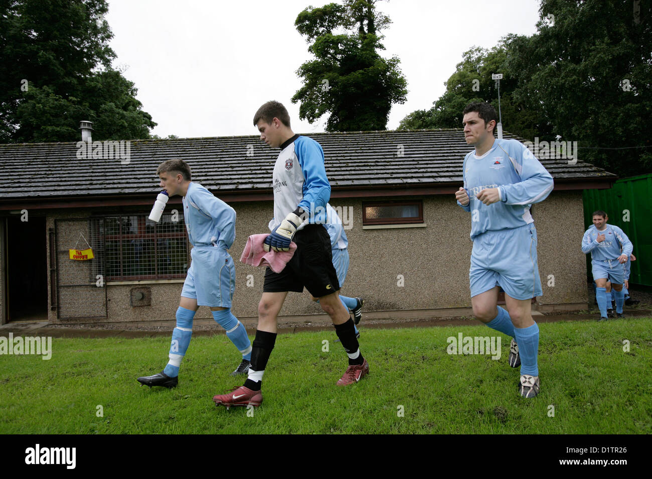 Gretna FC 2008 football players take to the field to play Kelso. - Stock Image