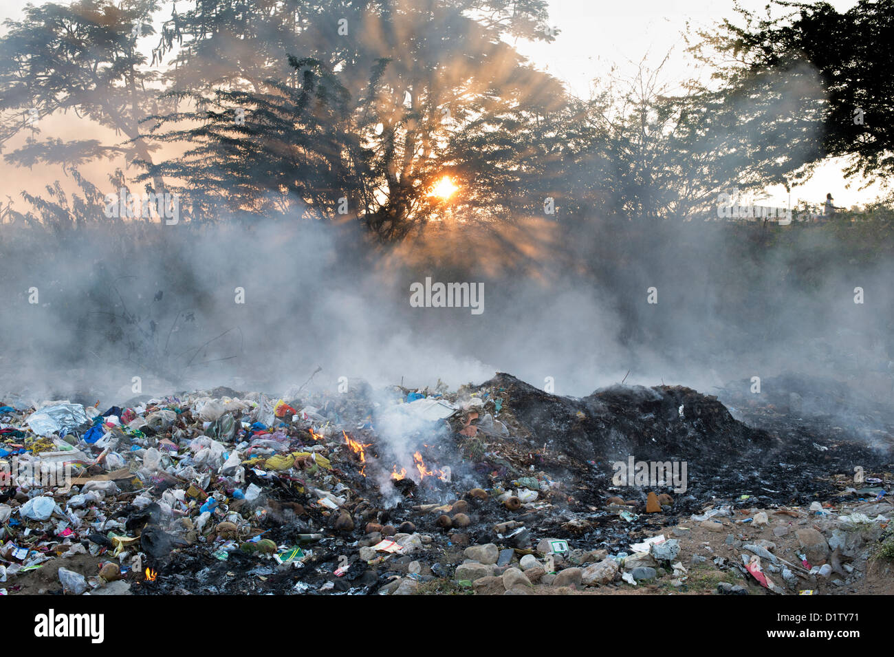 Household waste being burnt on the roadside. Andhra Pradesh, India - Stock Image