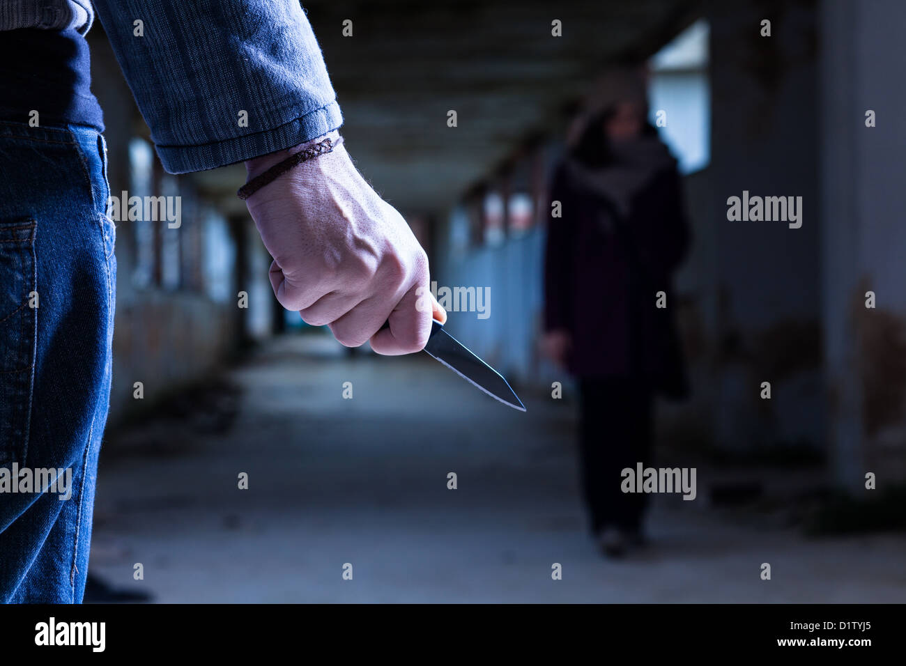 Criminal with Knife Waiting for a Woman - Stock Image
