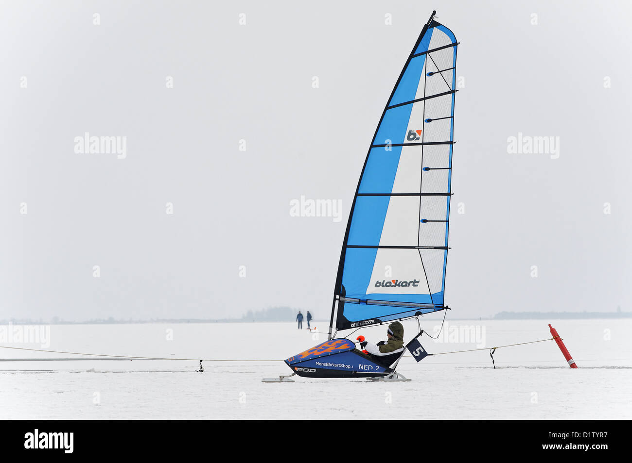 Wind Surfing on ice on a frozen lake in the Netherlands - Stock Image