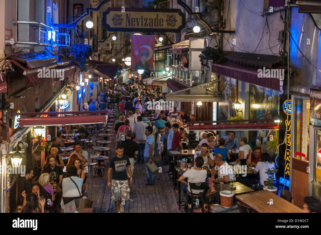 The lively Nevizade Street (Nevizade Sokak) in Beyoglu, located in the modern part of Istanbul,Turkey - Stock Image