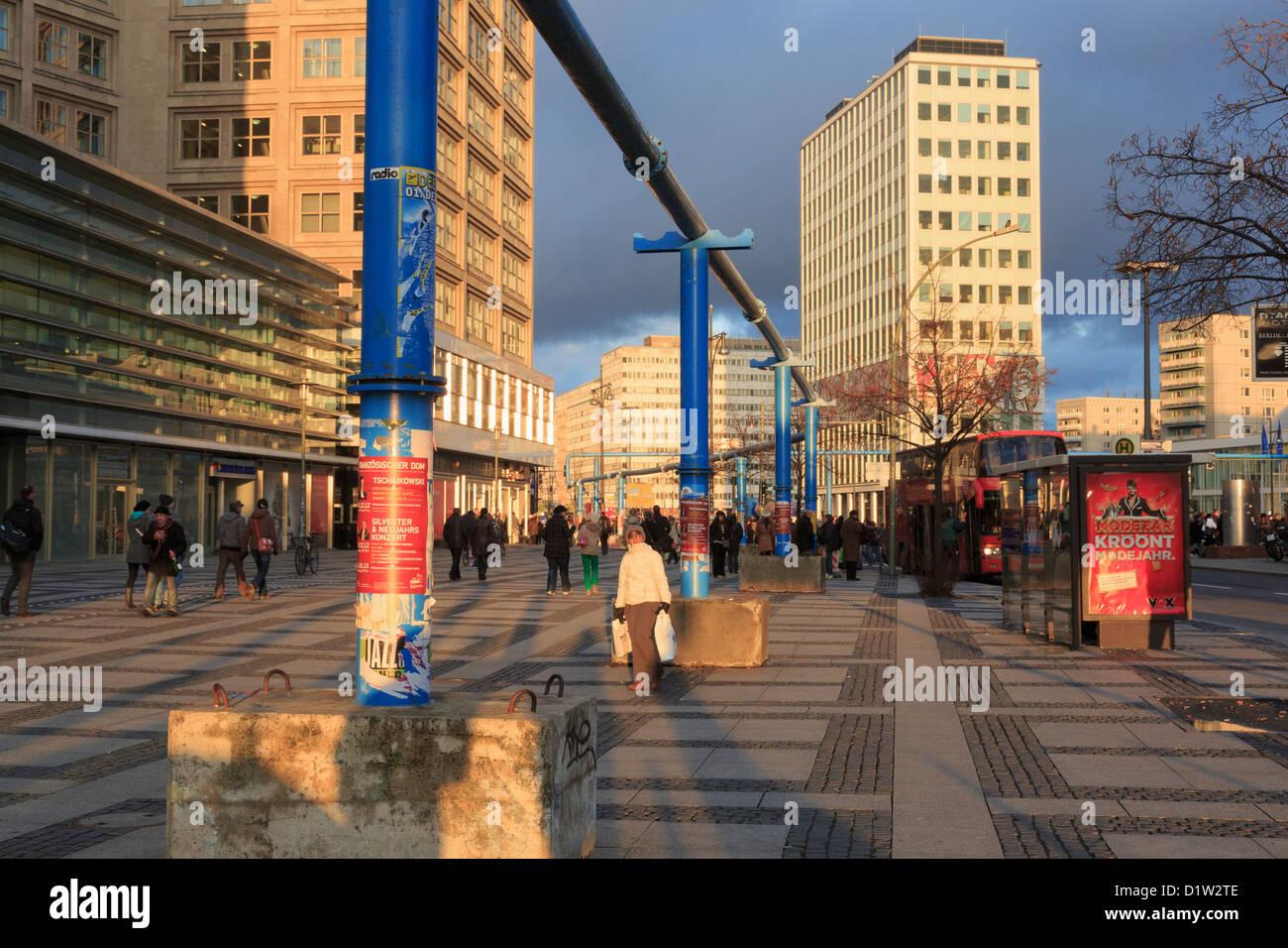 Street scene with overground pipes along Gruner Strasse, Alexanderplatz, Berlin Mitte, Germany, Europe - Stock Image
