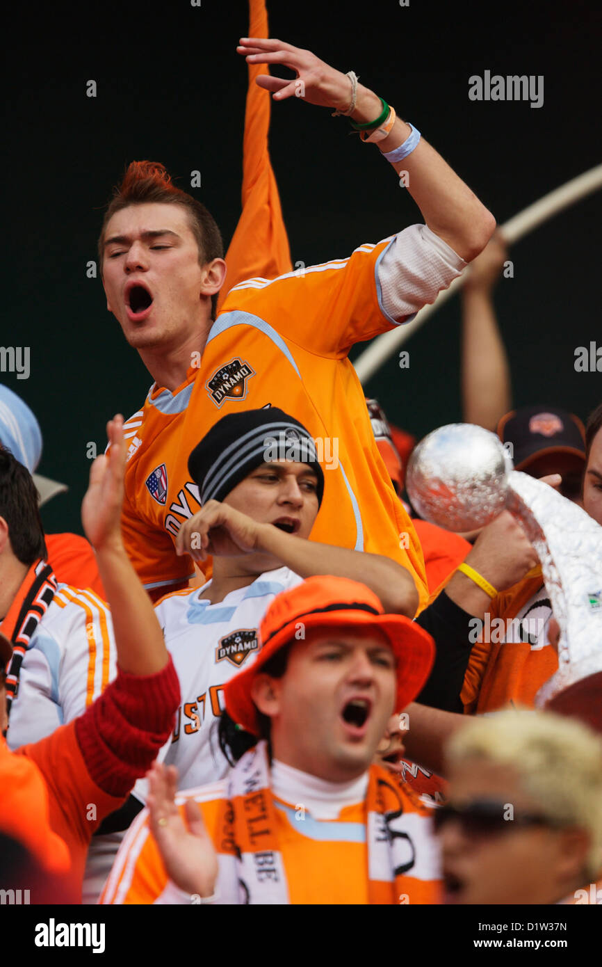 Houston Dynamo supporters cheer for their team at the MLS Cup championship soccer match against the New England - Stock Image