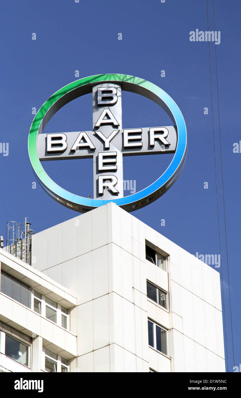 Berlin, Germany, Bayer AG company logo on a house roof - Stock Image