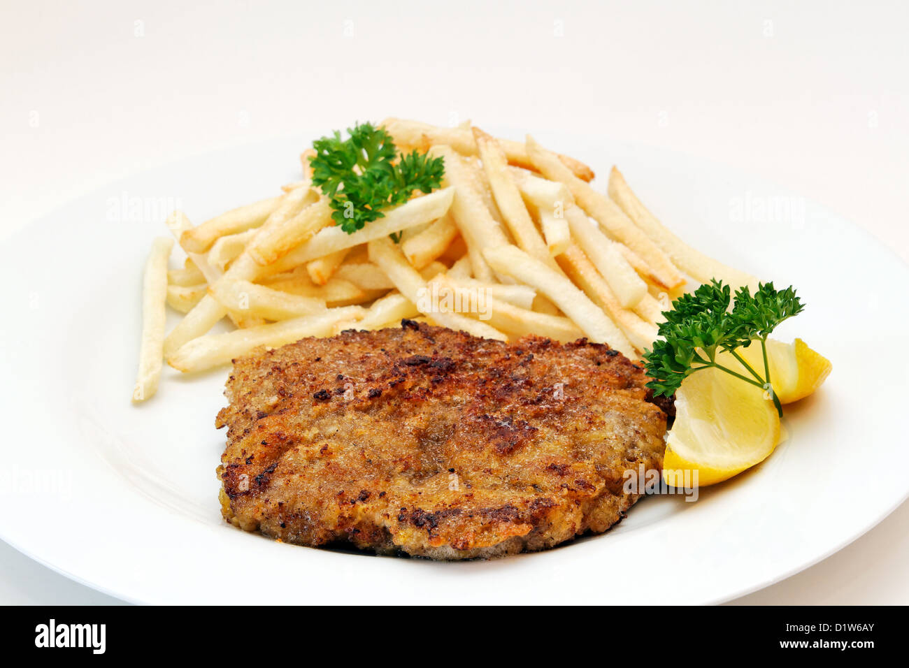 Beef cutlet with french fries - Stock Image