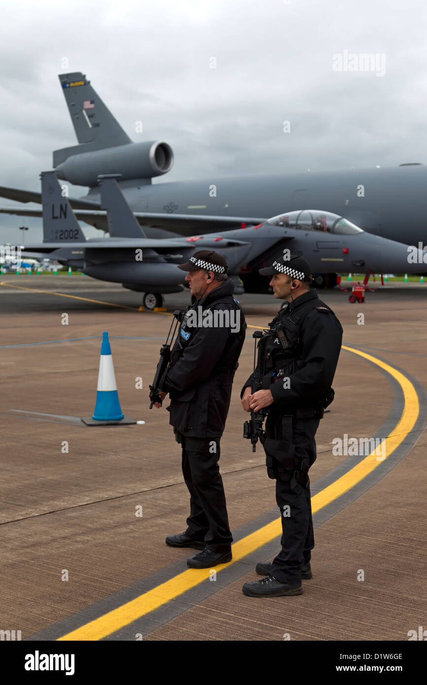 Two UK Armed Ministry of Defence (MOD) policemen at the Royal International Air Tattoo at RAF Fairford in Gloucestershire. - Stock Image