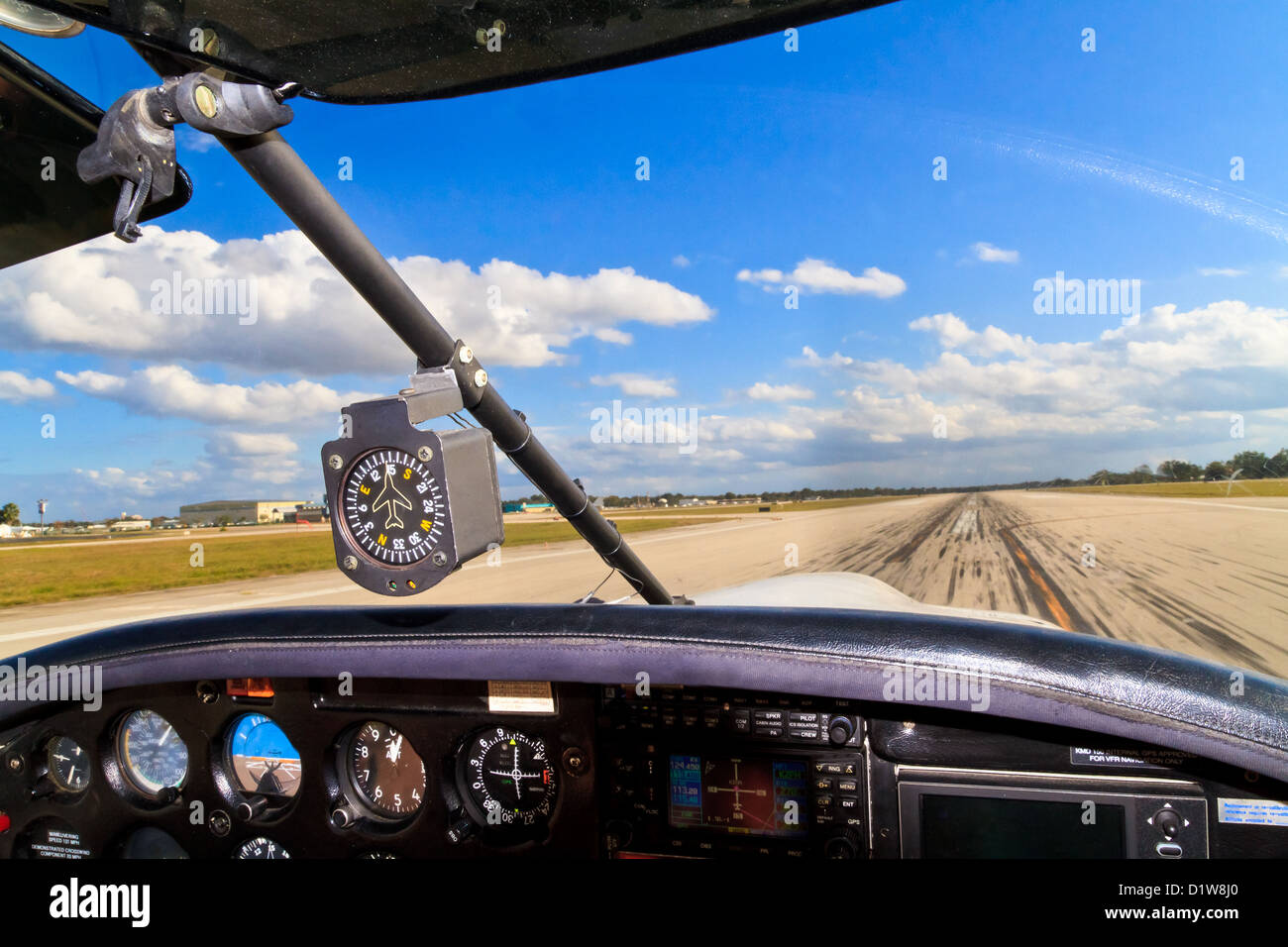 Cockpit view from small aircraft taking off from runway - Stock Image