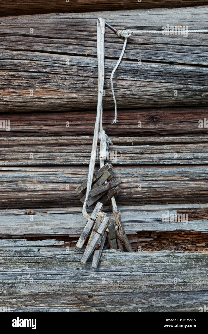 Old wooden clothespin on the rope - Stock Image