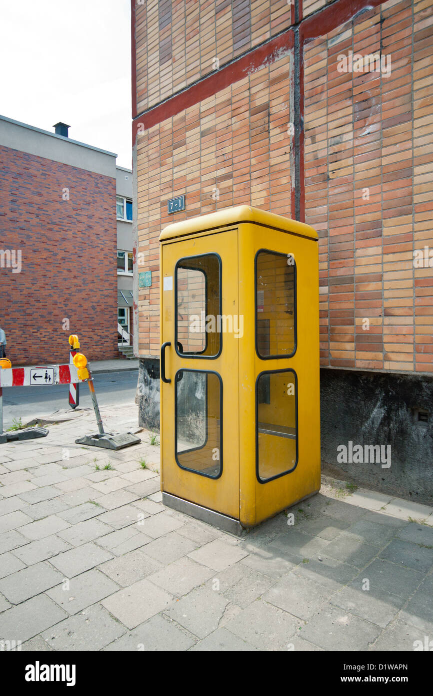 Old telephone booth in Greifswald, Germany - Stock Image