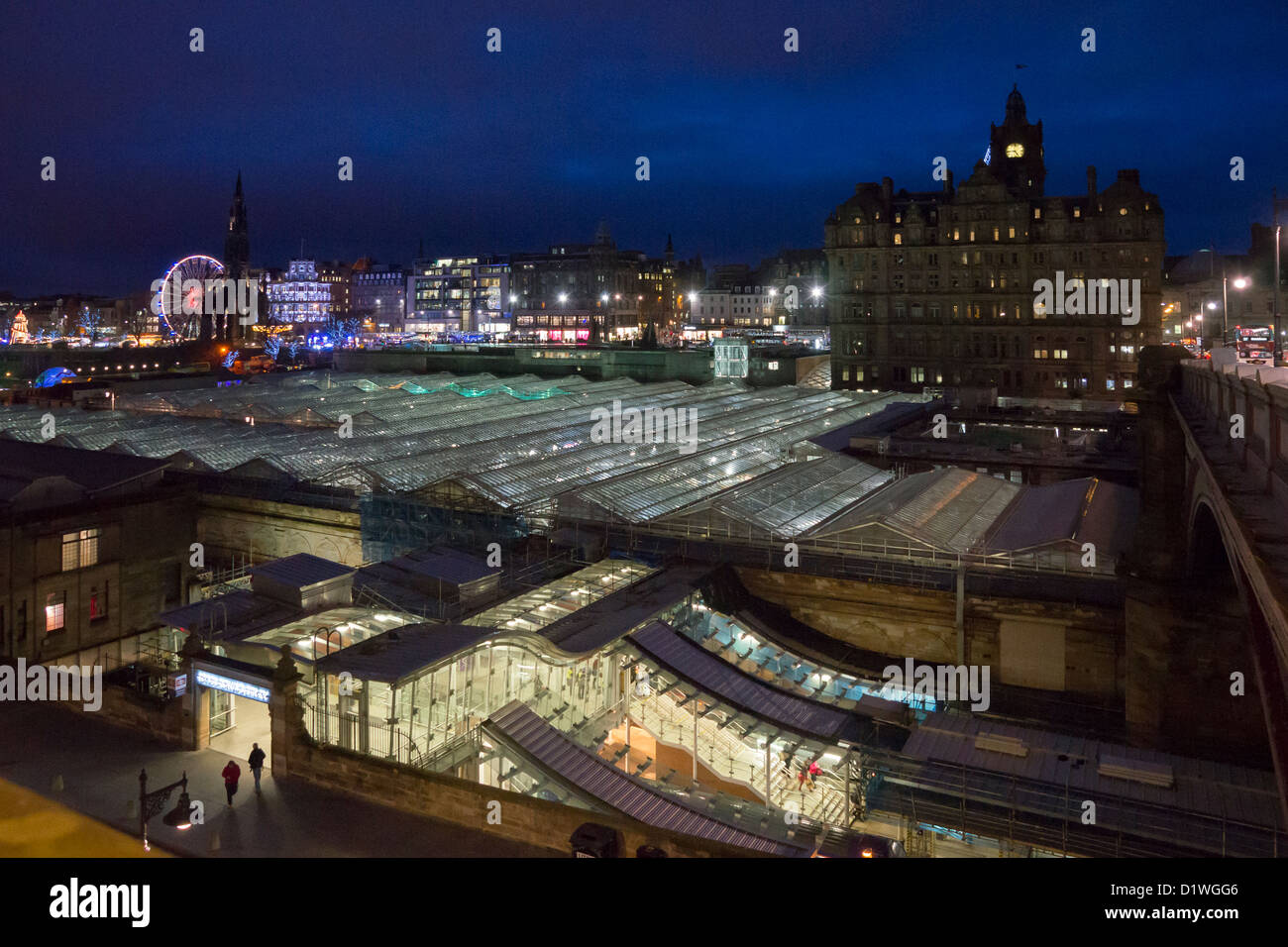 Night view of the new glass roof on Waverley Railway Station in Edinburgh Scotland with Xmas entertainment lights - Stock Image
