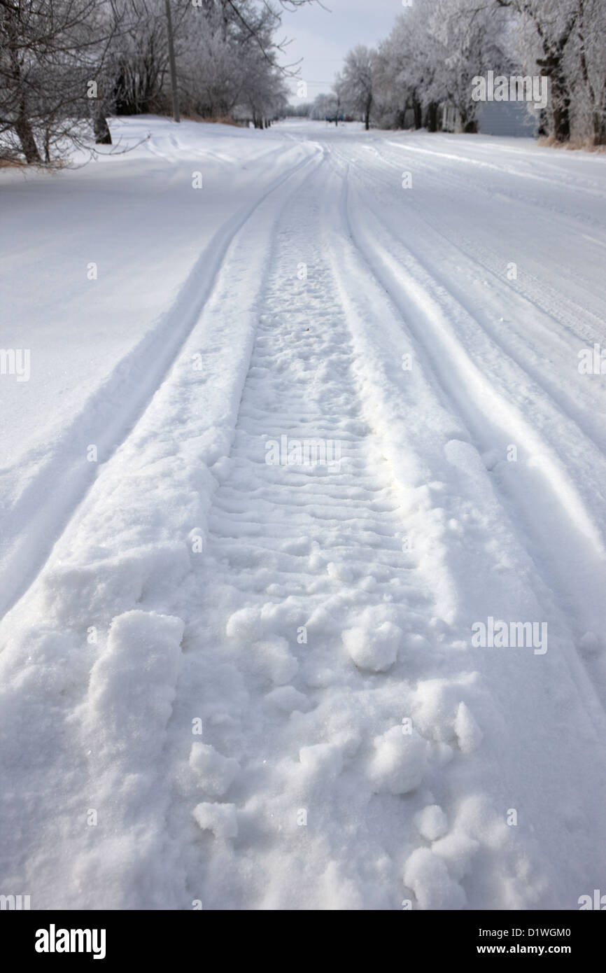 snowmobile tracks in snow in rural Forget Saskatchewan Canada - Stock Image