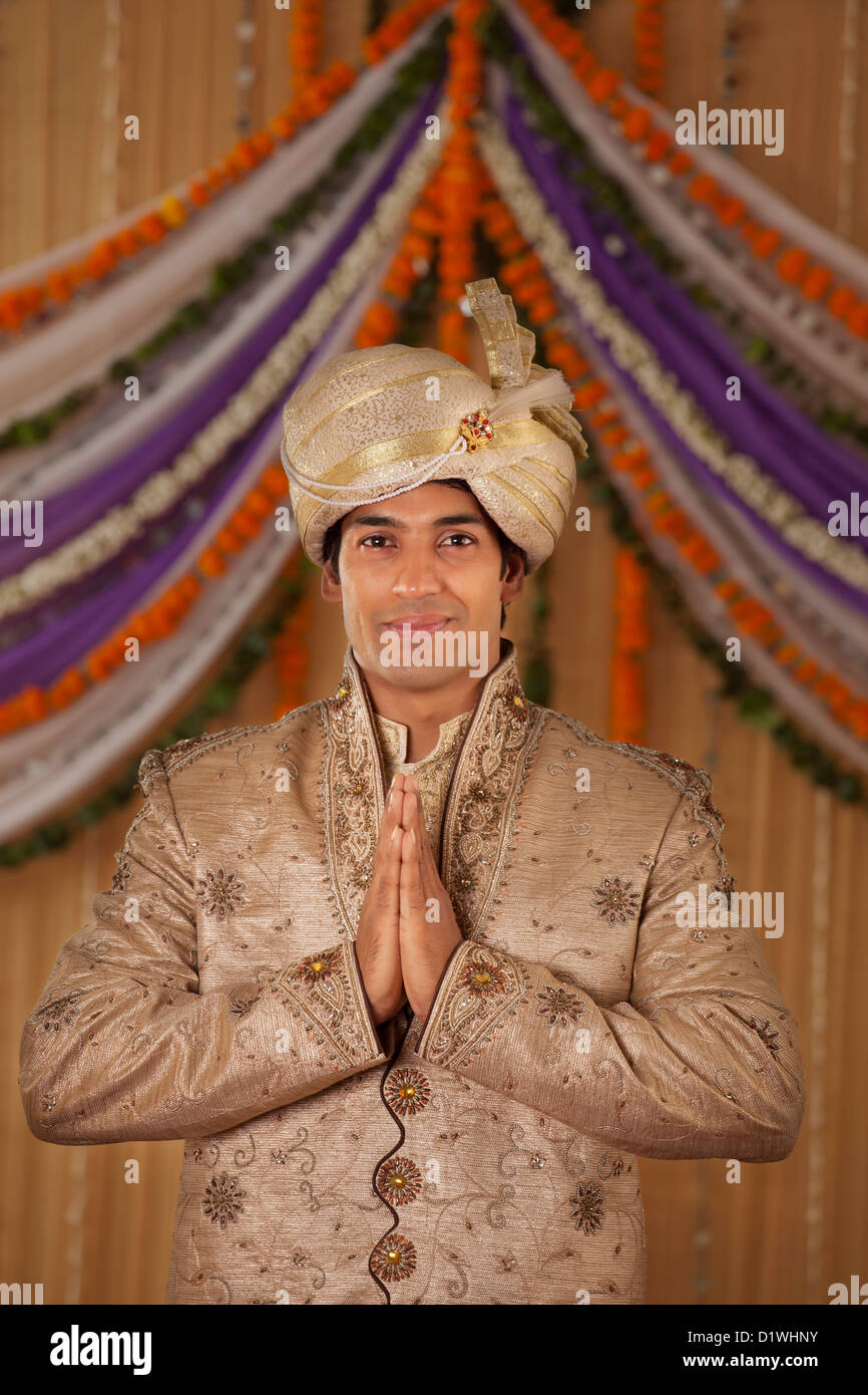 Portrait of Indian groom greeting - Stock Image