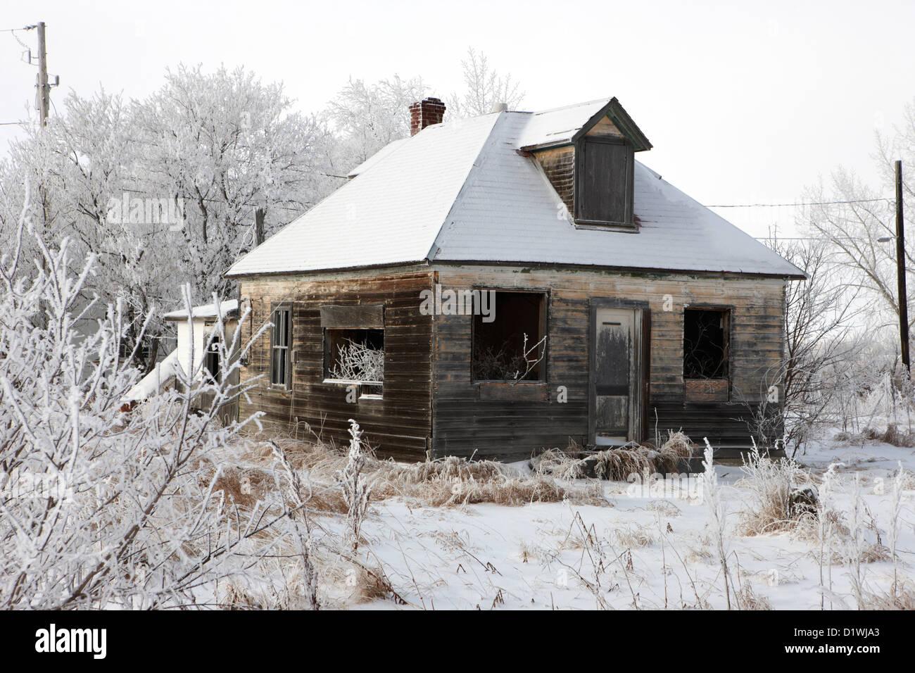 derelict empty wooden traditional house in rural village Forget Saskatchewan Canada - Stock Image