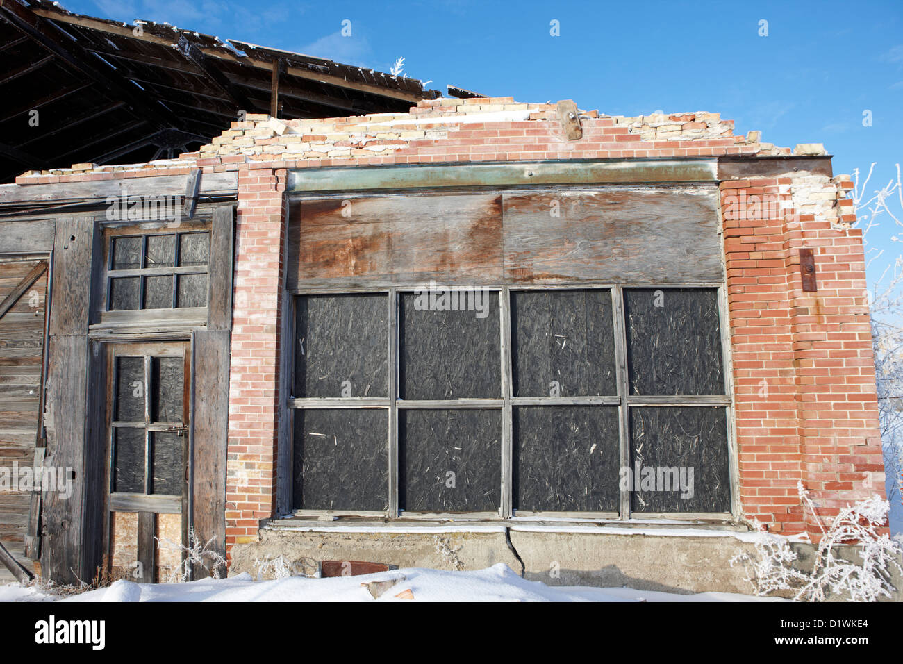 old traditional brick and wood building in disrepair Forget Saskatchewan Canada - Stock Image