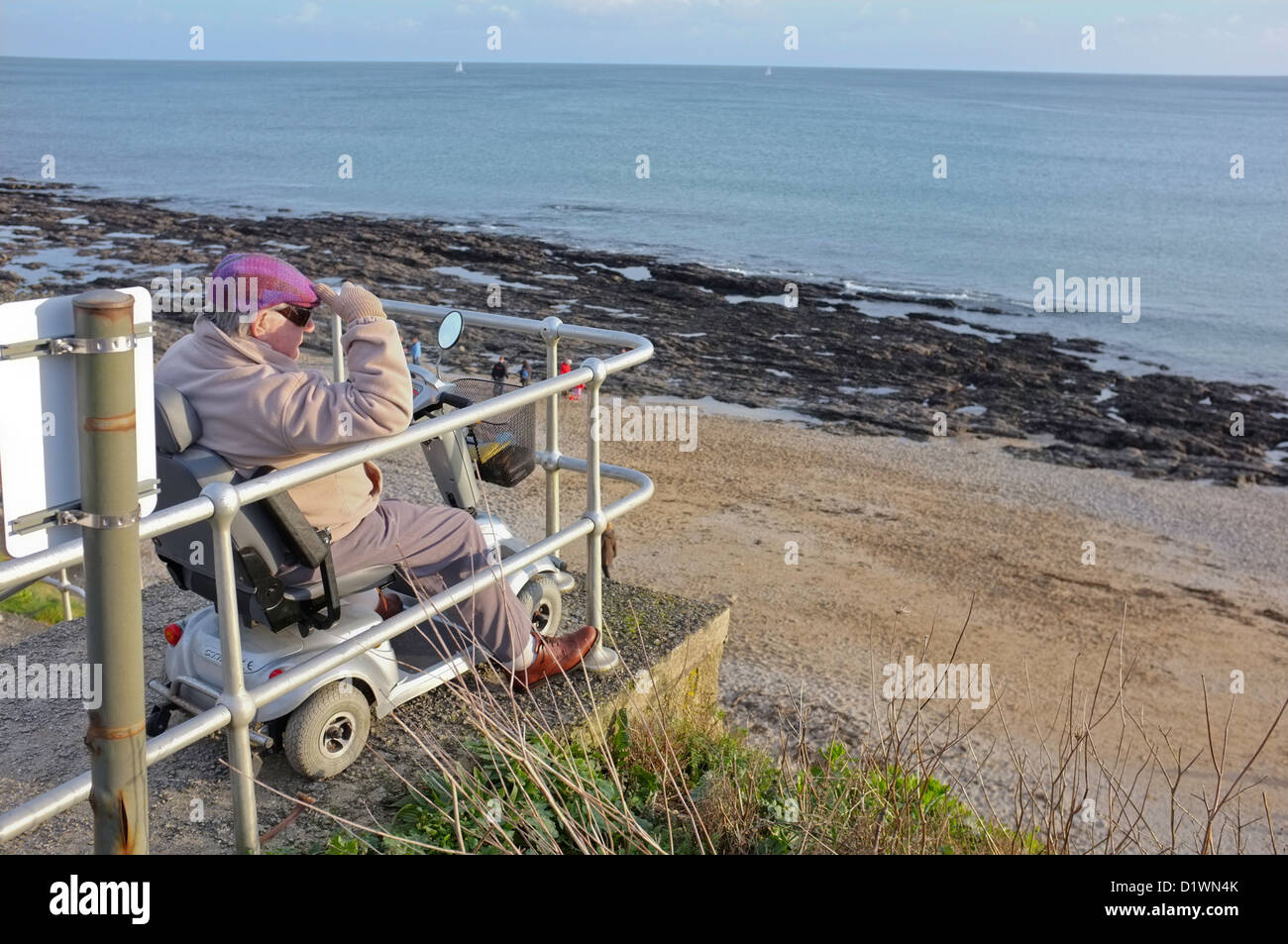 An old-age pensioner on the seafront of Falmouth, Cornwall, UK - Stock Image
