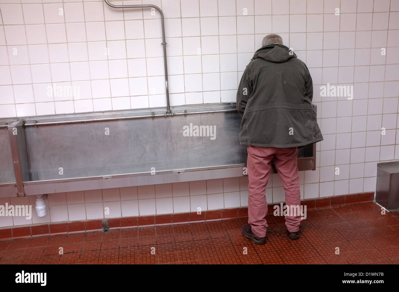 A Man Using Urinal