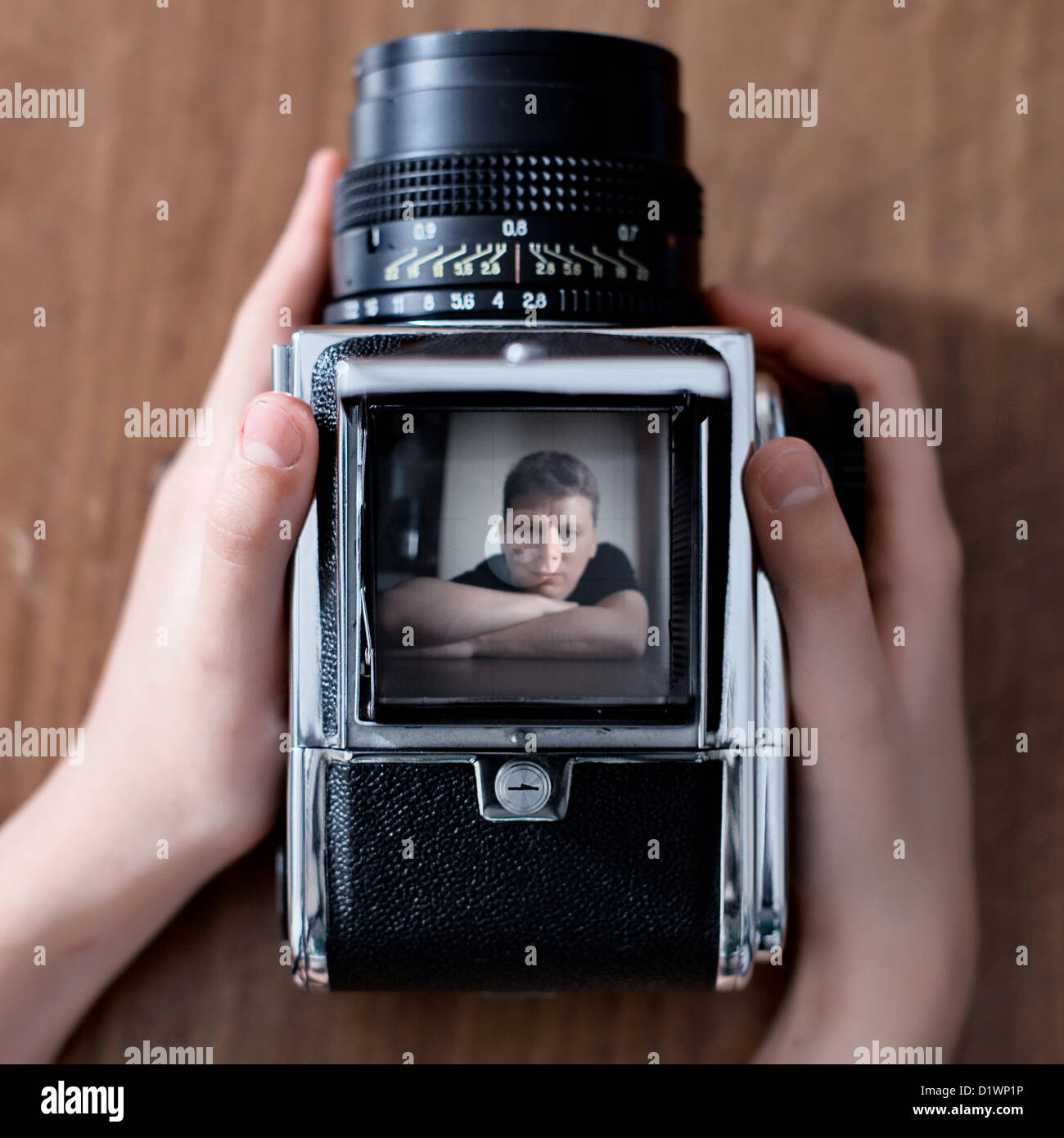 Man and the old camera - Stock Image