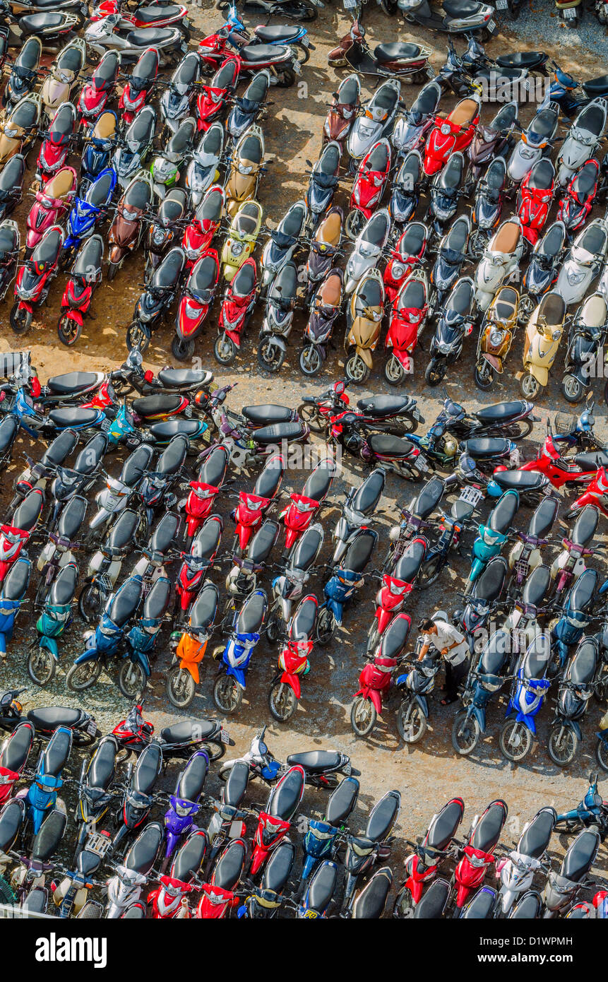 Motor scooters parked in large parking area in District 1, Ho CHi Minh City, Vietnam - Stock Image