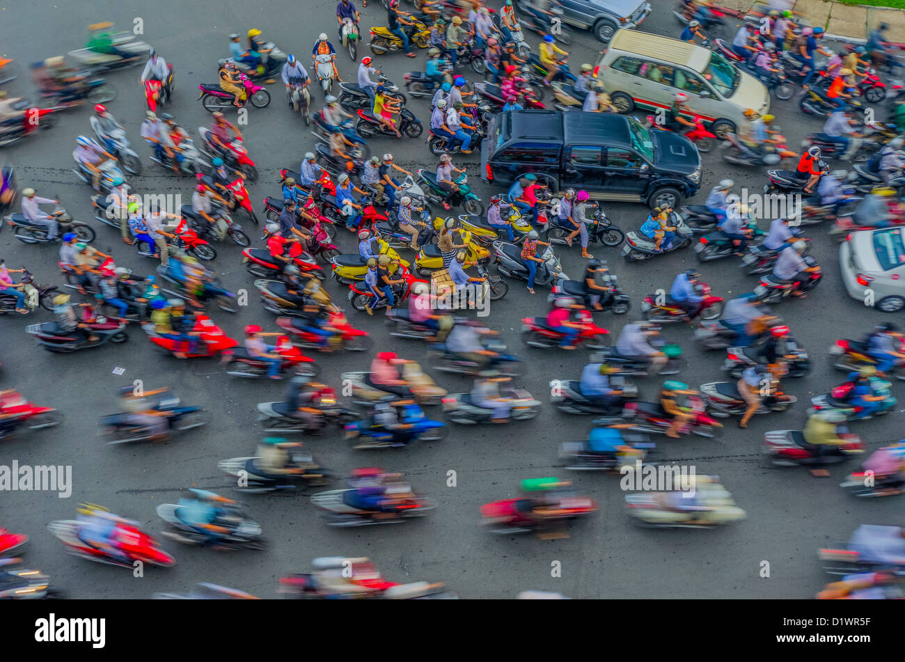 A sea of mopeds during rush hour in central Saigon, Ho Chi Minh, Vietnam, Asia - Stock Image