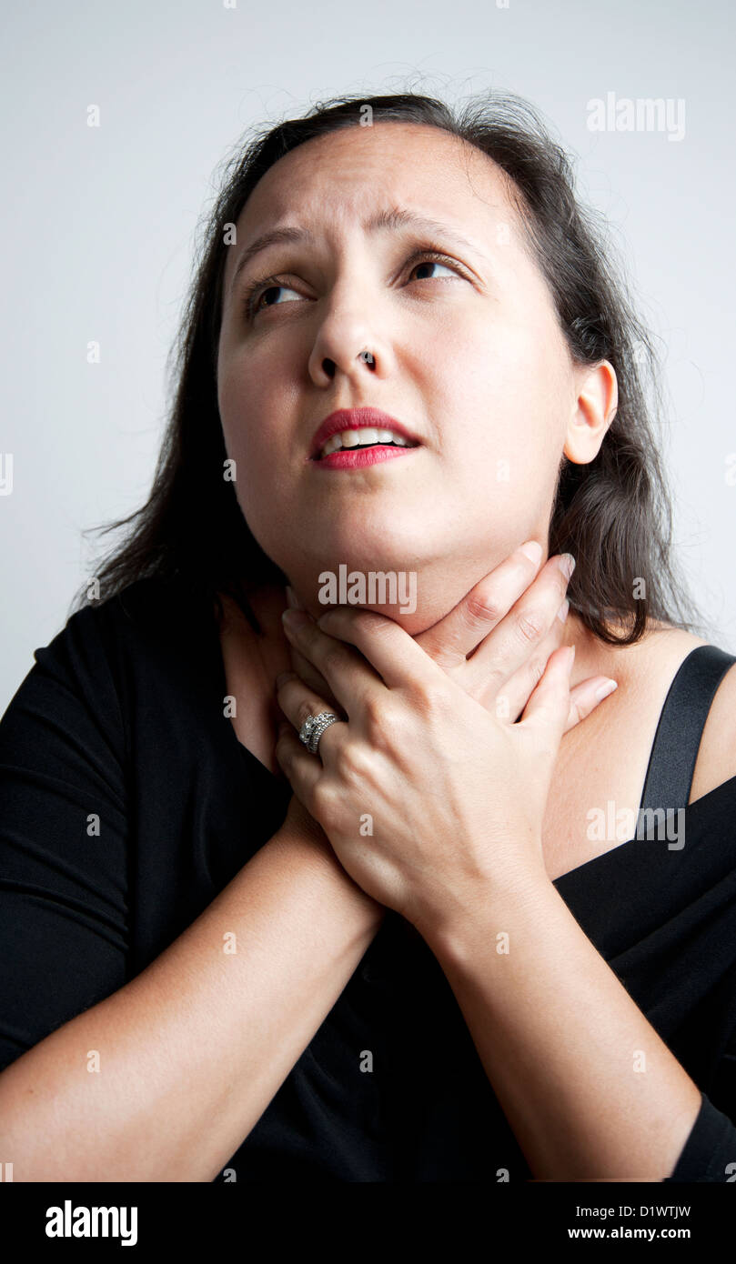 https://c8.alamy.com/comp/D1WTJW/a-woman-actress-grabbing-her-own-throat-in-a-very-dramatic-way-D1WTJW.jpg