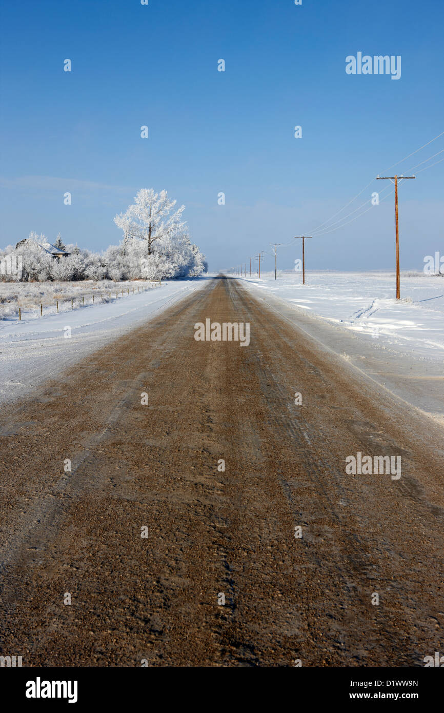 salt and grit covered rural small road in Forget Saskatchewan Canada - Stock Image