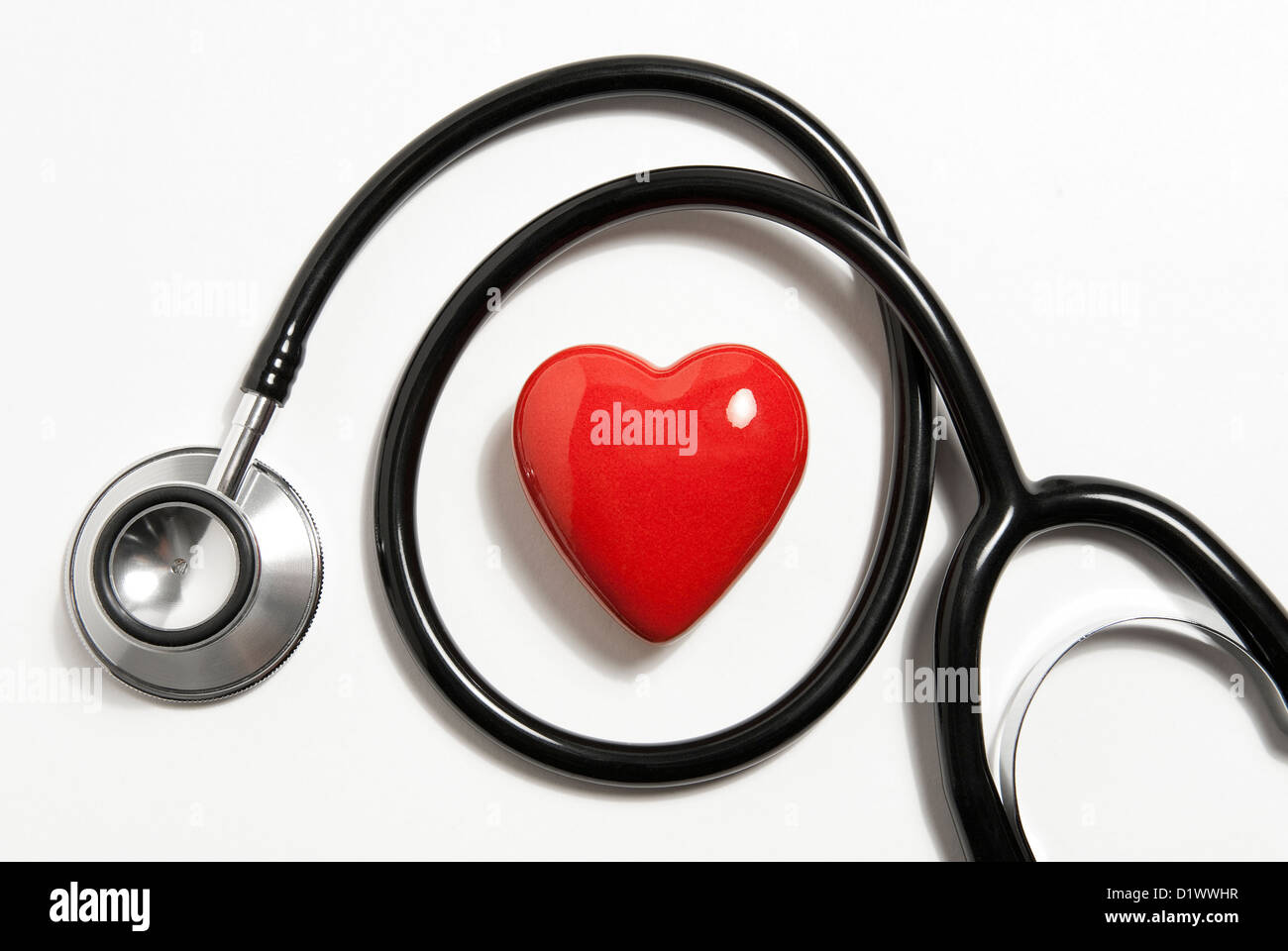 stethoscope and red heart shape - Stock Image