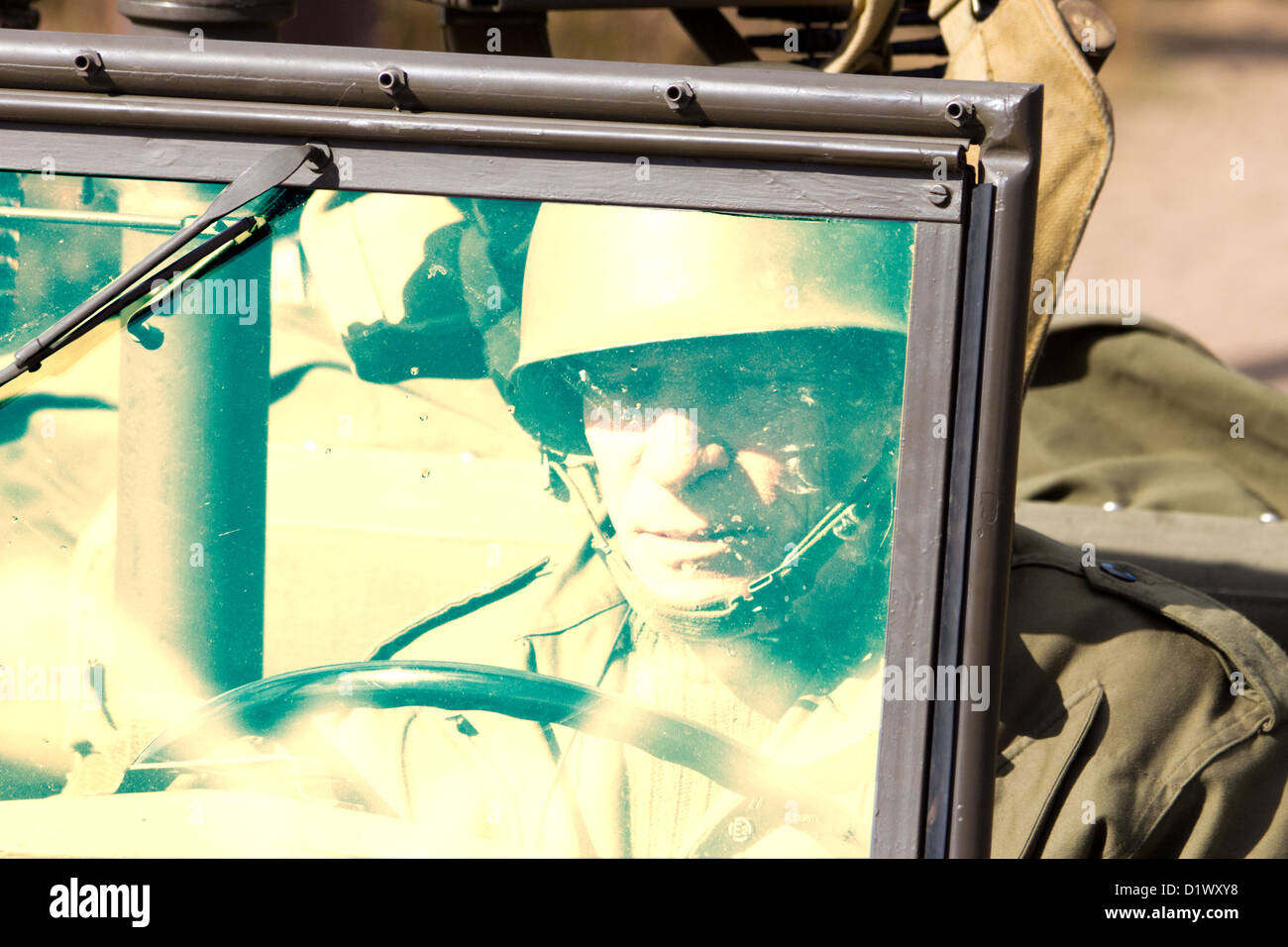 American soldier in a WW2 jeep - Stock Image