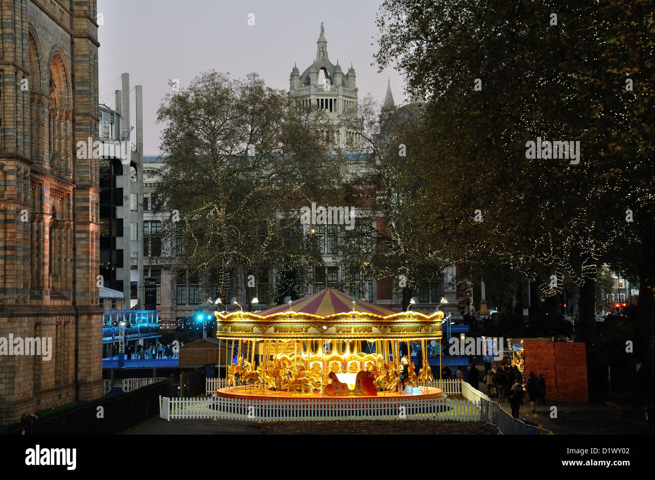 Carousel outside Natural History Museum, London with V & A Museum in background - Stock Image