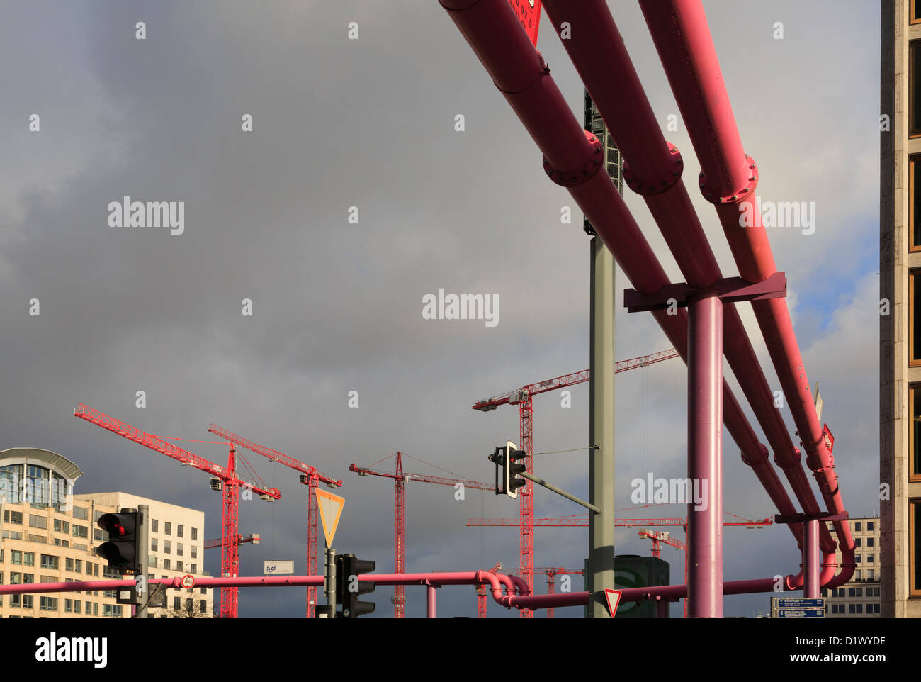 Overground pipes and cranes in new development on death strip in former east German sector of city at Potsdamer - Stock Image