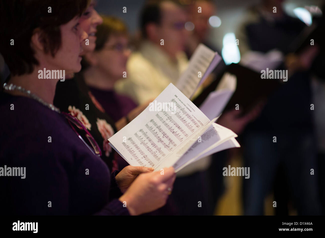 A small amateur choir singing christmas carols in welsh, Aberystwyth, Wales, UK - Stock Image