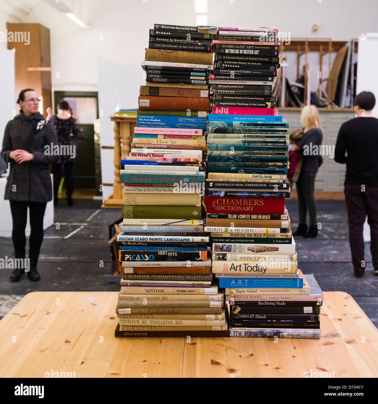 Stacks of art history theory text books in a gallery Aberystwyth University School of Art, part of an exhibition - Stock Image