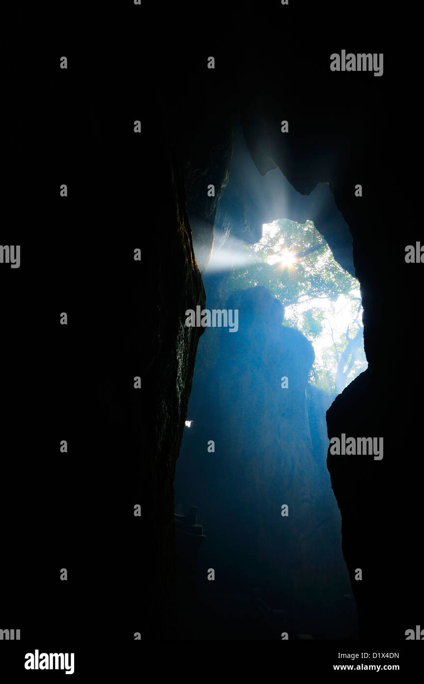 Sunbeam Illuminating cave, Marble mountain, Danang, Vietnam - Stock Image