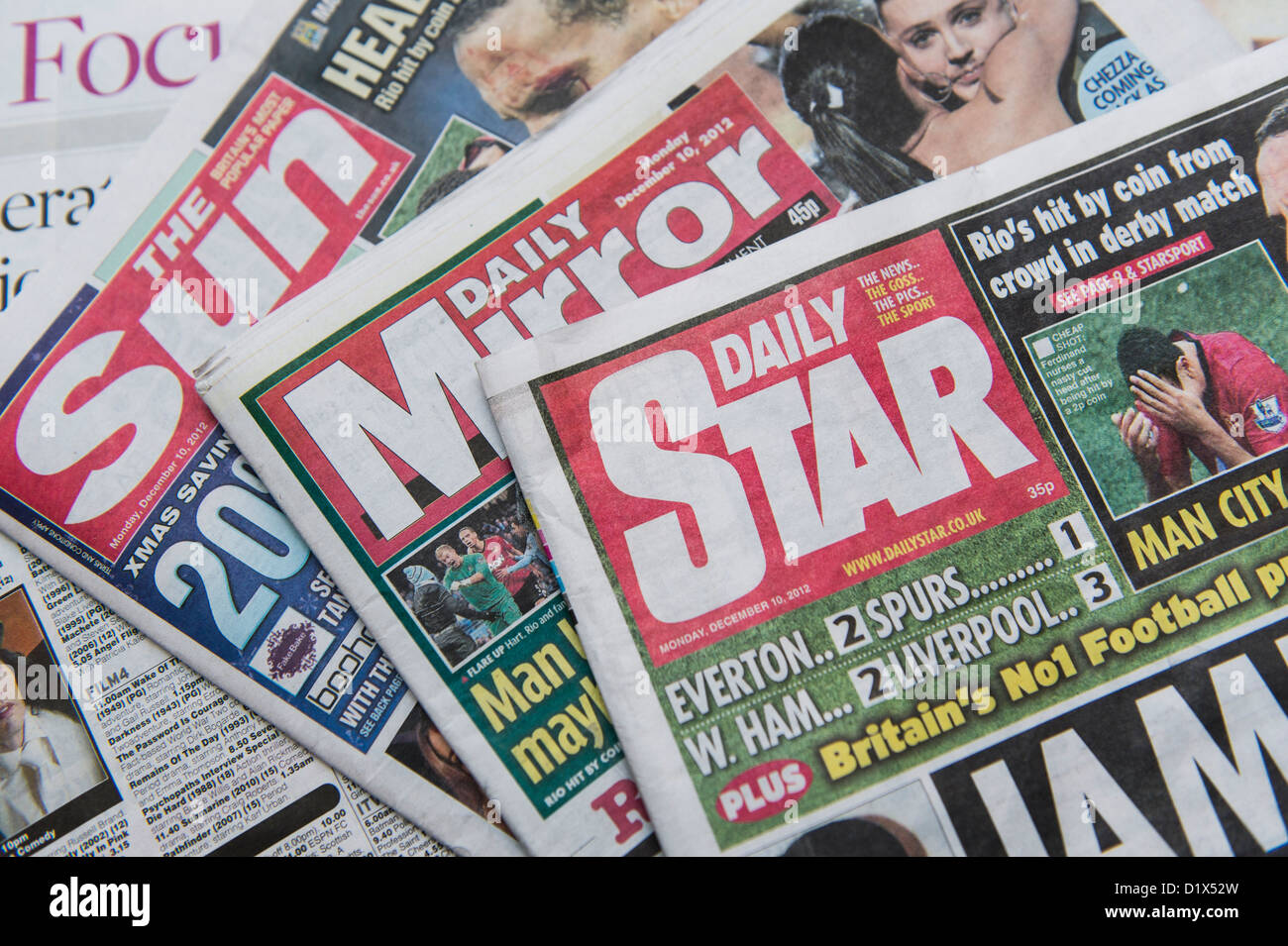 The front pages and mastheads of UK 'Red Top' tabloid tabloids Sun Star Mirror British English daily national newspapers Stock Photo
