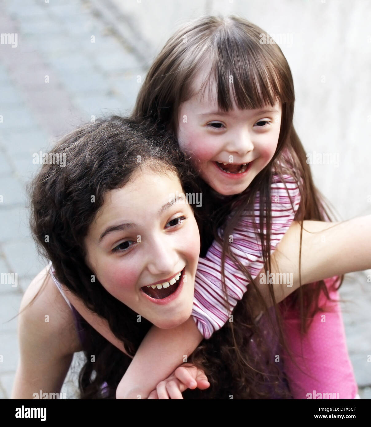 Portrait of beautiful young girls outside - Stock Image