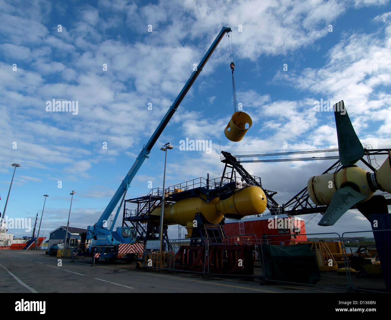 Two experimental tidal energy devices being assembled for testing at EMEC in Orkney, on the quayside in Kirkwall - Stock Image