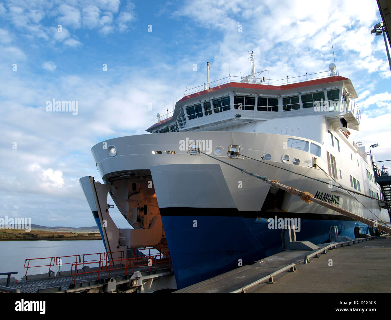 A Scottish Ferry moored in Stromness in the Orkney Islands, waiting to embark car and lorries - Stock Image