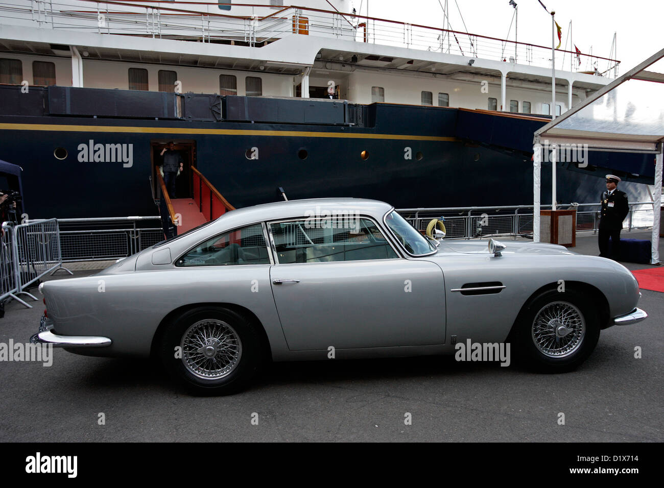 The original James Bond Aston Martin DB5 (sporting Swiss number plates) parked next to the Royal Yacht Britannia - Stock Image