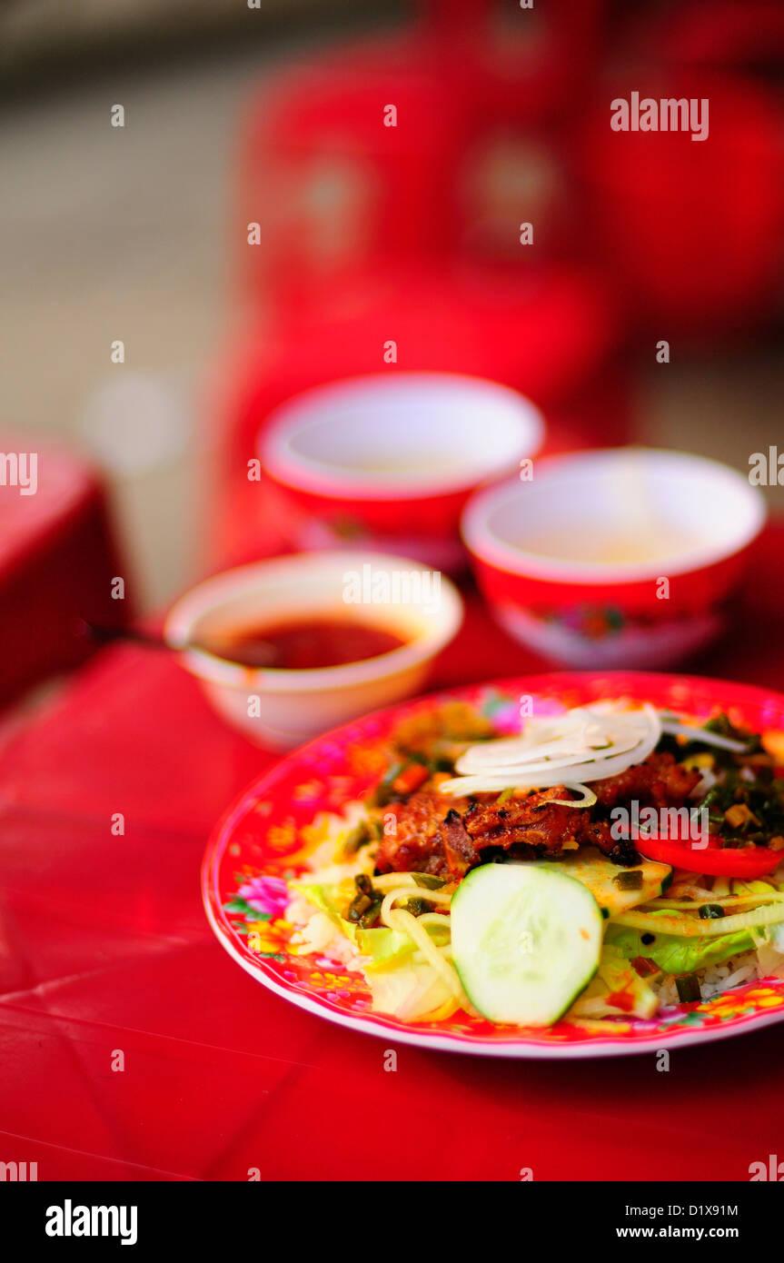 Com Tam (Fractured or Broken rice grains), street food, Vietnam, Asia - Stock Image