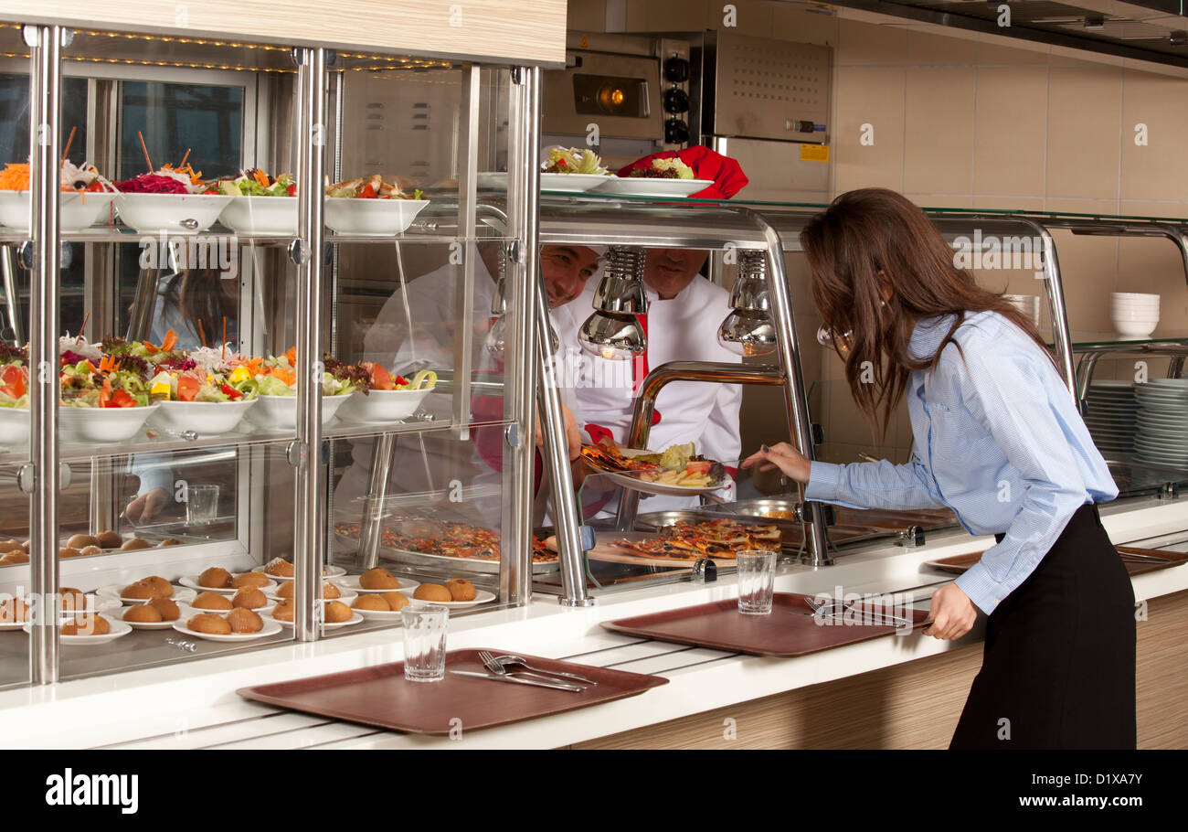 Business woman take cafeteria lunch - Stock Image