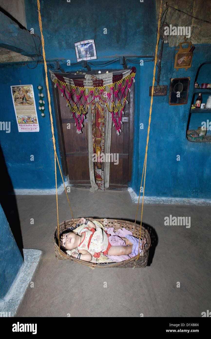 Baby in a hammock , Gond tribe, Gadchiroli, Maharashtra, India. - Stock Image