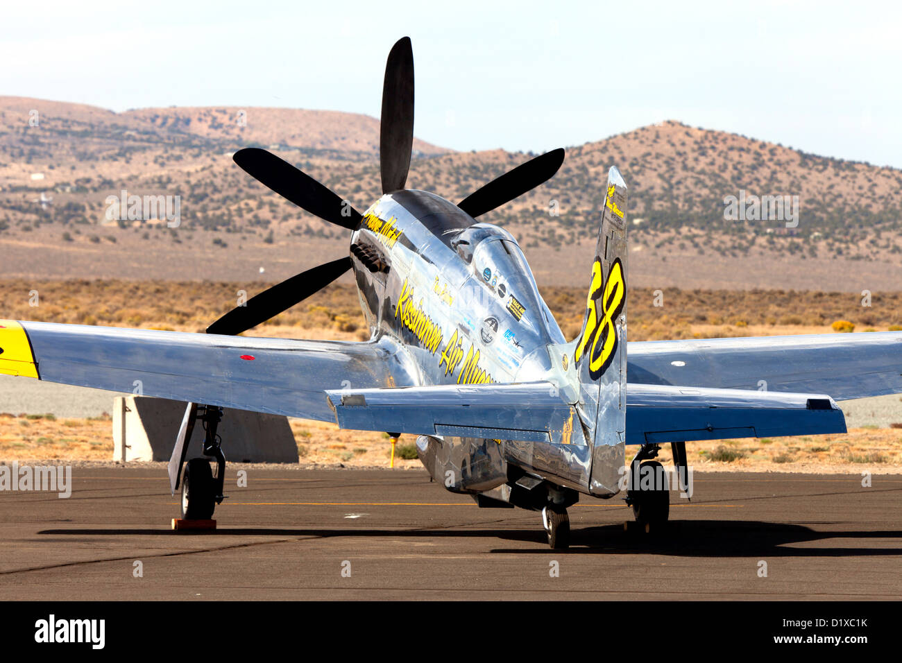 P-51 Mustang Unlimited Air Racer Precious Metal on the ramp at the 2012 Reno National Championship Air Races - Stock Image