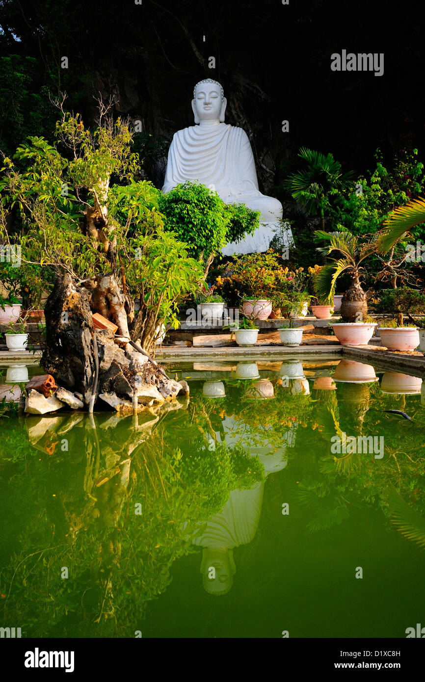 Large white Buddha statue at entrance of Thuy Son, Marble mountain, Danang, Vietnam - Stock Image