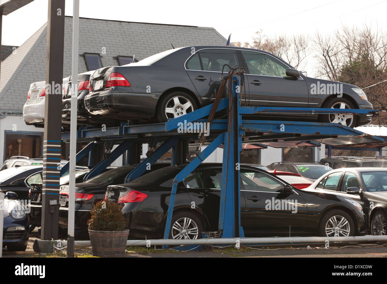 Cars on parking lift - Stock Image